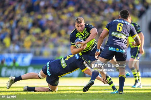 Lyon France 23 April 2017 Ross Molony of Leinster is tackled by Arthur Iturria left and Damien Chouly of ASM Clermont Auvergne during the European...