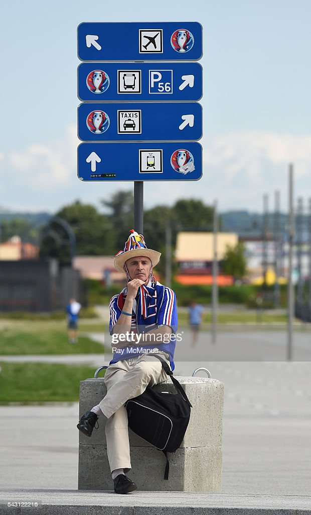 Lyon , France - 26 June 2016; A France supporter relaxes near the main entrance of the stadium ahead of the UEFA Euro 2016 Round of 16 match between France and Republic of Ireland at Stade des Lumieres in Lyon, France.