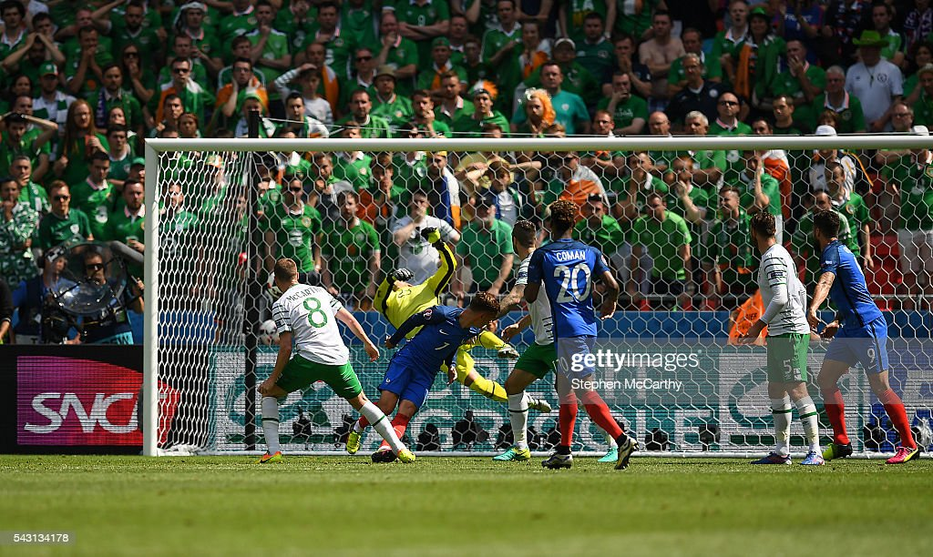 Lyon , France - 26 June 2016; Antoine Griezmann of France scores his side's first goal of the game during the UEFA Euro 2016 Round of 16 match between France and Republic of Ireland at Stade des Lumieres in Lyon, France.