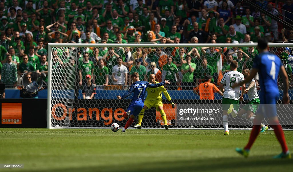 Lyon , France - 26 June 2016; Antoine Griezmann of France shoots to score his side's second goal of the game in the UEFA Euro 2016 Round of 16 match between France and Republic of Ireland at Stade des Lumieres in Lyon, France.