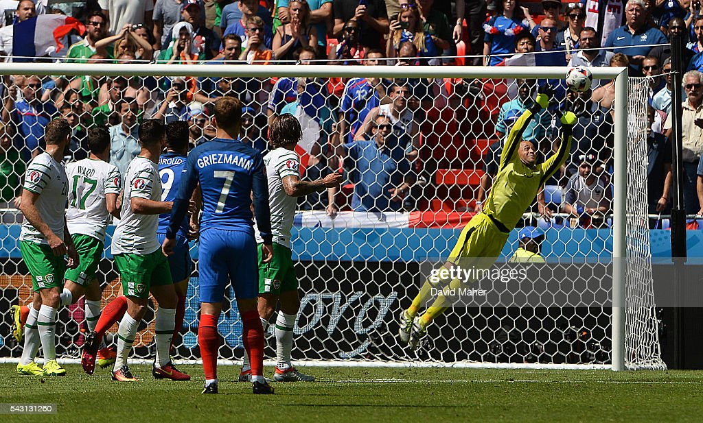 Lyon , France - 26 June 2016; <a gi-track='captionPersonalityLinkClicked' href=/galleries/search?phrase=Darren+Randolph&family=editorial&specificpeople=3947785 ng-click='$event.stopPropagation()'>Darren Randolph</a> of Republic of Ireland saves a free kick from <a gi-track='captionPersonalityLinkClicked' href=/galleries/search?phrase=Paul+Pogba&family=editorial&specificpeople=5805302 ng-click='$event.stopPropagation()'>Paul Pogba</a> of France during the UEFA Euro 2016 Round of 16 match between France and Republic of Ireland at Stade des Lumieres in Lyon, France.