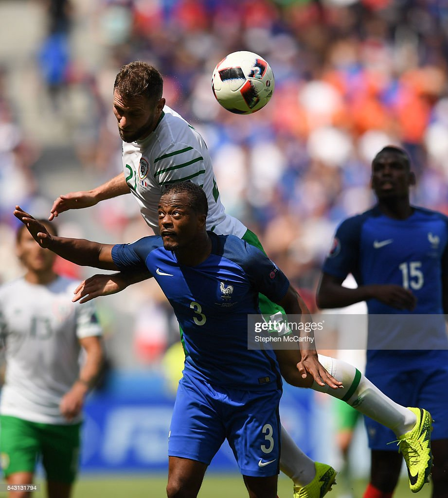 Lyon , France - 26 June 2016; <a gi-track='captionPersonalityLinkClicked' href=/galleries/search?phrase=Daryl+Murphy&family=editorial&specificpeople=658367 ng-click='$event.stopPropagation()'>Daryl Murphy</a> of Republic of Ireland in action against Patrice Evra of France during the UEFA Euro 2016 Round of 16 match between France and Republic of Ireland at Stade des Lumieres in Lyon, France.