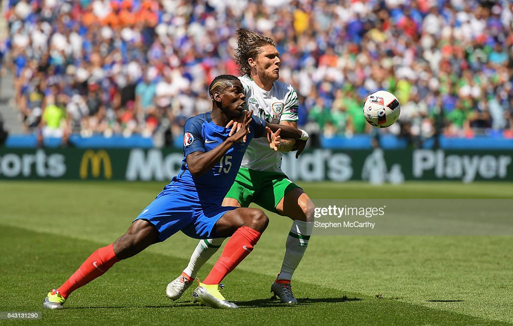 Lyon , France - 26 June 2016; <a gi-track='captionPersonalityLinkClicked' href=/galleries/search?phrase=Jeff+Hendrick+-+Soccer+Player&family=editorial&specificpeople=15923342 ng-click='$event.stopPropagation()'>Jeff Hendrick</a> of Republic of Ireland is challenged by <a gi-track='captionPersonalityLinkClicked' href=/galleries/search?phrase=Paul+Pogba&family=editorial&specificpeople=5805302 ng-click='$event.stopPropagation()'>Paul Pogba</a> of France during the UEFA Euro 2016 Round of 16 match between France and Republic of Ireland at Stade des Lumieres in Lyon, France.