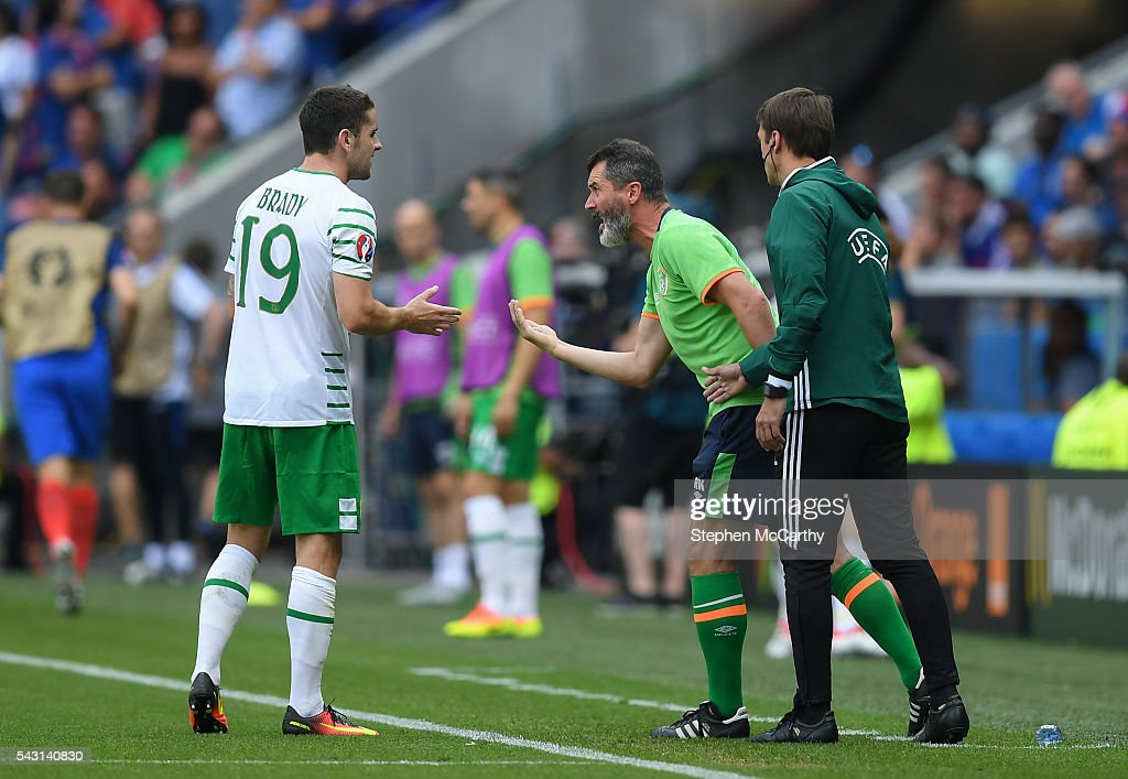 Lyon , France - 26 June 2016; Republic of Ireland assistant manager Roy Keane in conversation with Robbie Brady during the UEFA Euro 2016 Round of 16 match between France and Republic of Ireland at Stade des Lumieres in Lyon, France.