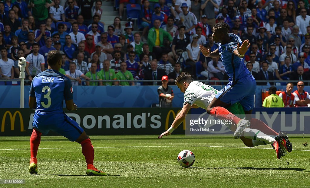Lyon , France - 26 June 2016; Republic of Ireland's <a gi-track='captionPersonalityLinkClicked' href=/galleries/search?phrase=Shane+Long&family=editorial&specificpeople=661194 ng-click='$event.stopPropagation()'>Shane Long</a> is fouled by <a gi-track='captionPersonalityLinkClicked' href=/galleries/search?phrase=Paul+Pogba&family=editorial&specificpeople=5805302 ng-click='$event.stopPropagation()'>Paul Pogba</a> of France for a penalty in the UEFA Euro 2016 Round of 16 match between France and Republic of Ireland at Stade des Lumieres in Lyon, France.