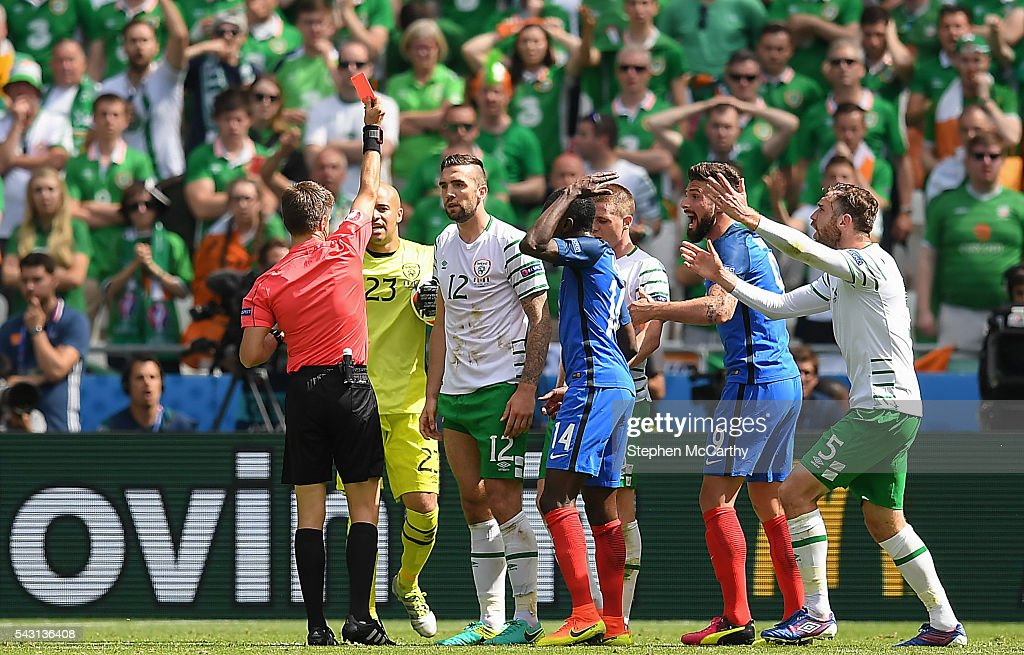 Lyon , France - 26 June 2016; <a gi-track='captionPersonalityLinkClicked' href=/galleries/search?phrase=Shane+Duffy+-+Soccer+Player&family=editorial&specificpeople=16068436 ng-click='$event.stopPropagation()'>Shane Duffy</a> of Republic of Ireland receives a red card from referee Nicola Rizzoli from Italy during the UEFA Euro 2016 Round of 16 match between France and Republic of Ireland at Stade des Lumieres in Lyon, France.