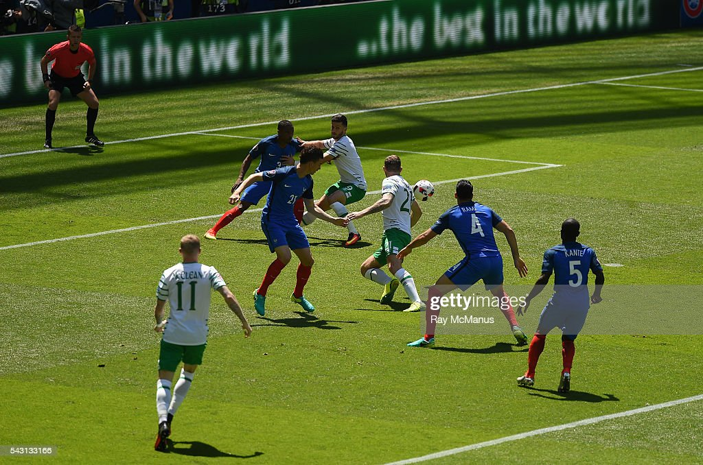 Lyon , France - 26 June 2016; Shane Long of Republic of Ireland fights for possesion in the French penalty box during the UEFA Euro 2016 Round of 16 match between France and Republic of Ireland at Stade des Lumieres in Lyon, France.