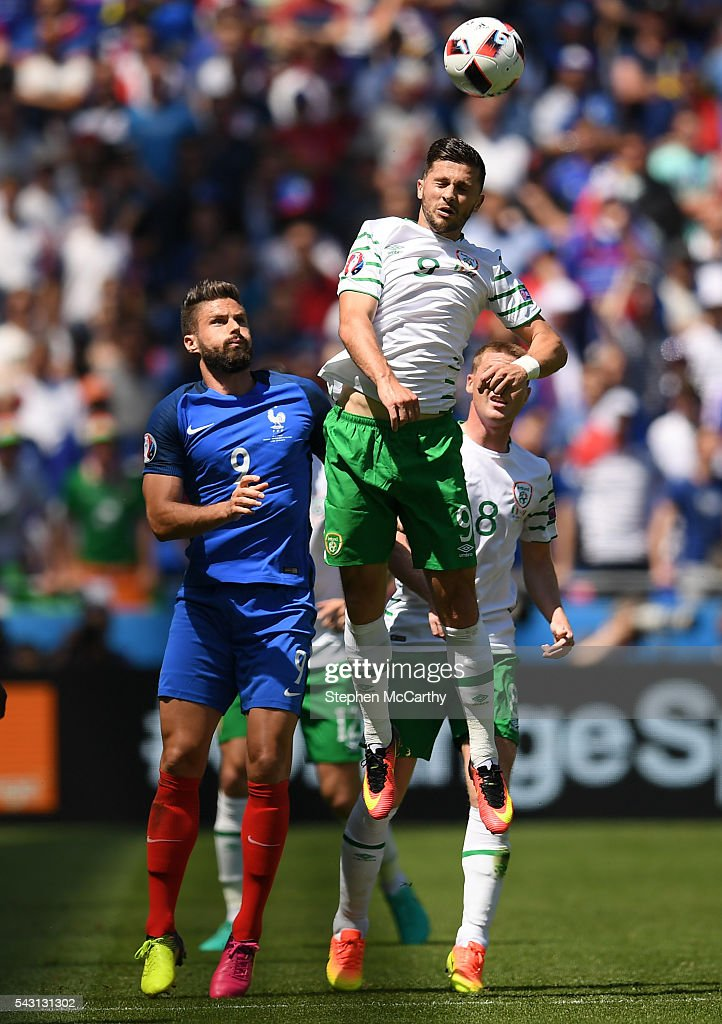 Lyon , France - 26 June 2016; <a gi-track='captionPersonalityLinkClicked' href=/galleries/search?phrase=Shane+Long&family=editorial&specificpeople=661194 ng-click='$event.stopPropagation()'>Shane Long</a> of Republic of Ireland in action against <a gi-track='captionPersonalityLinkClicked' href=/galleries/search?phrase=Olivier+Giroud&family=editorial&specificpeople=5678034 ng-click='$event.stopPropagation()'>Olivier Giroud</a> of France during the UEFA Euro 2016 Round of 16 match between France and Republic of Ireland at Stade des Lumieres in Lyon, France.