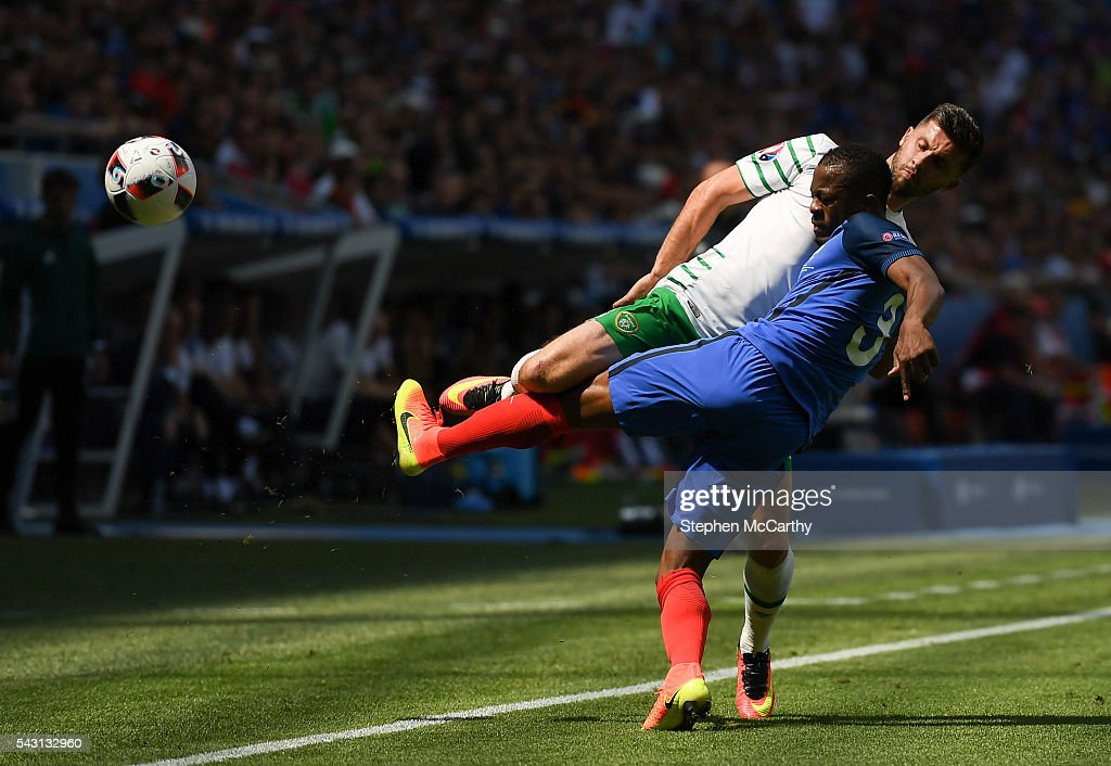Lyon , France - 26 June 2016; Shane Long of Republic of Ireland tackles Patrice Evra of France during the UEFA Euro 2016 Round of 16 match between France and Republic of Ireland at Stade des Lumieres in Lyon, France.