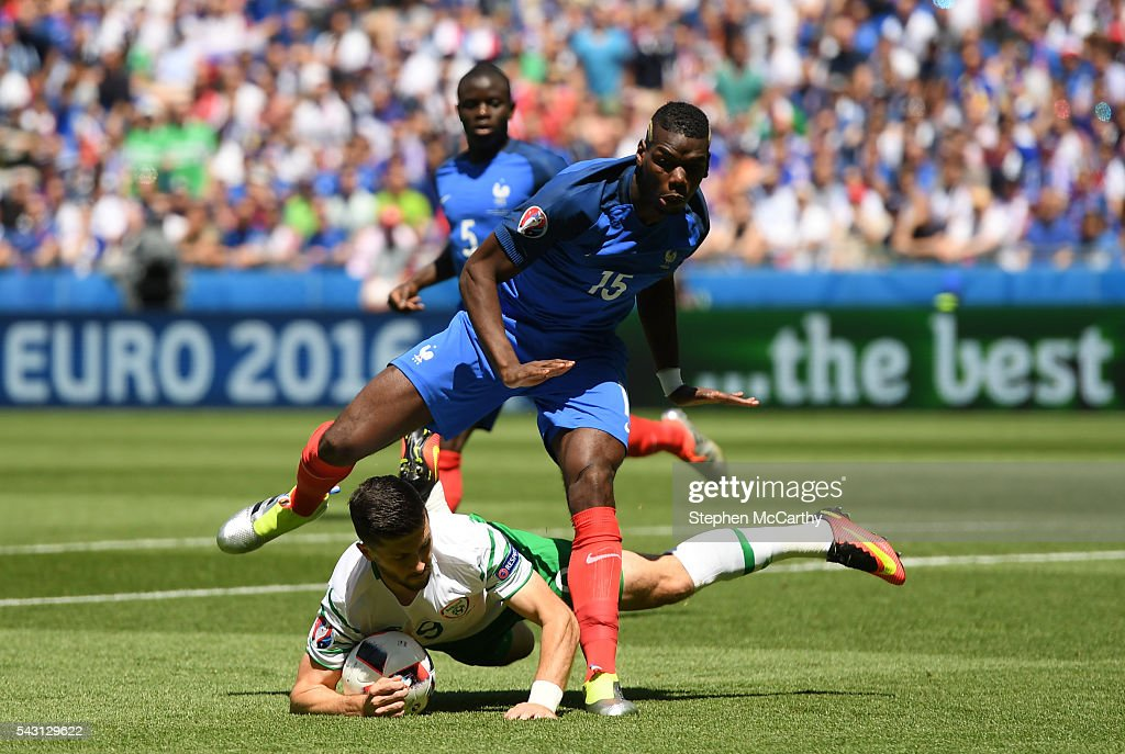 Lyon , France - 26 June 2016; Shane Long of the Republc of Ireland is fouled by Paul Pogba of France for a penalty in the UEFA Euro 2016 Round of 16 match between France and Republic of Ireland at Stade des Lumieres in Lyon, France.