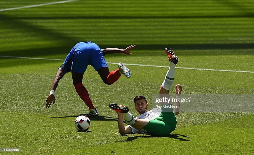 Lyon , France - 26 June 2016; Shane Long of the Republic of Ireland is fouled by Paul Pogba of Frane for a penalty in the UEFA Euro 2016 Round of 16 match between France and Republic of Ireland at Stade des Lumieres in Lyon, France.