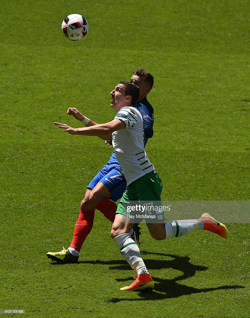 Lyon , France - 26 June 2016; Stephen Ward of Republic of Ireland challenges Antoine Griezmann of France during the UEFA Euro 2016 Round of 16 match between France and Republic of Ireland at Stade des Lumieres in Lyon, France.