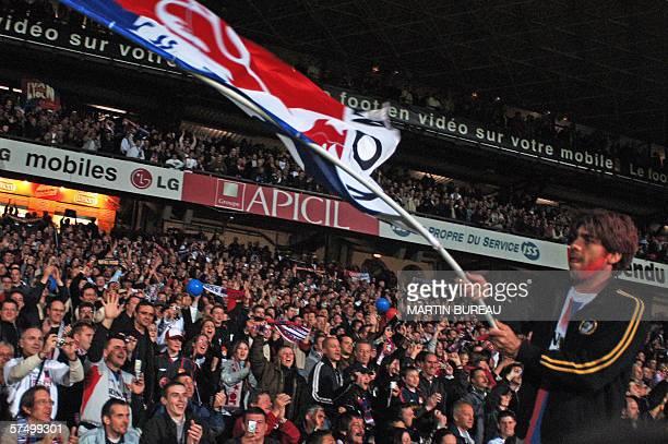 Lyon's Brazilian midfielder Juninho celebrates Lyon's fifth French champion's title after the French L1 football match against SaintEtienne 30 April...