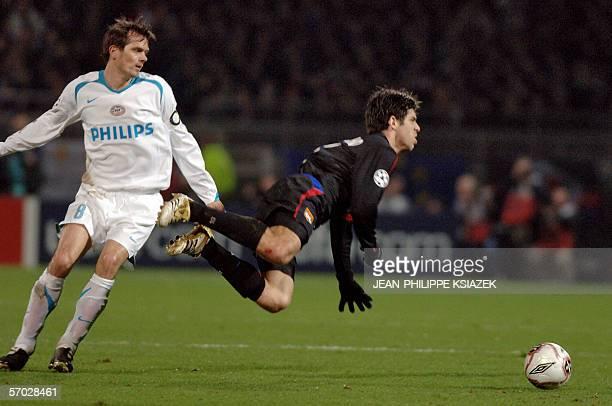 Lyon's Brazilian midfielder Juninho vies vith Eindhoven Dutch midfielder Phillip Cocu during their Champions League football match Lyon/PSV Eindhoven...