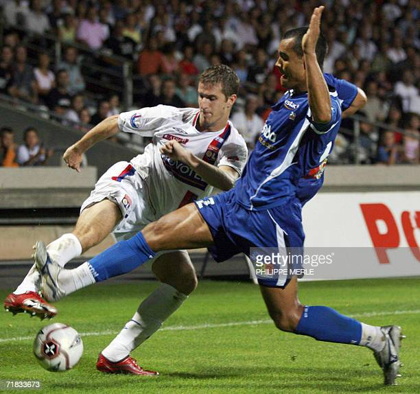 Lyon's French defender Francois Clerc vies with Troyes' French defender Gregory Paisley during their French L1 football match Lyon vs Troyes 09...