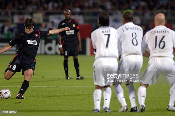 Olympique Lyonnais' Brazilian midfielder Juninho shoots the second goal during the Champion's League first round football match Lyon vs Real Madrid...