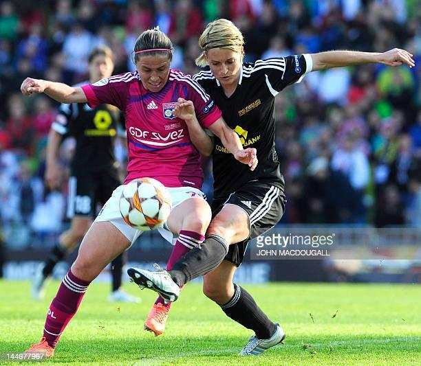 Lyon midfielder Camille Abily and Frankfurt's defender Saskia Bartusiak vie for the ball during the UEFA Women's Champions League final football...