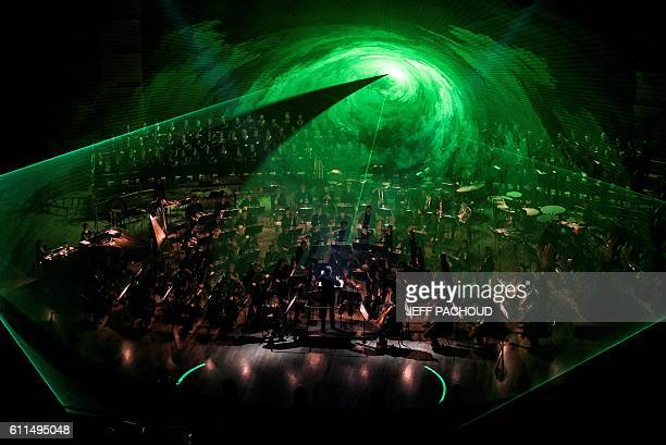 TOPSHOT Lyon National Orchestra led by Dutch conductor Ernst van Tiel performs the Star Wars soundtrack on September 29 2016 at Lyon auditorium / AFP...