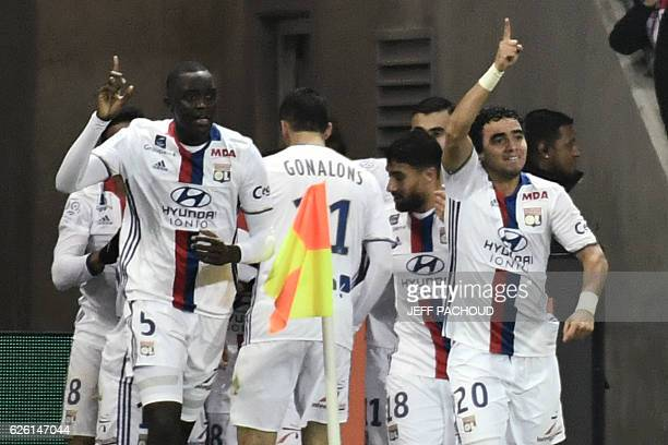 Lyon players celebrate after their teammate French forward Mathieu Valbuena scored a goal during the French L1 football match between Olympique...