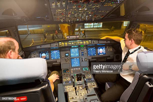 Lyon Saint Exupéry Aéroport France February 15 2013 Pilot and copilot check the plane at the end of a fly
