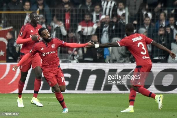 Lyon's Alexadre Lacazette celebrates with after scoring a goal during the UEFA Europa League second leg quarter final football match between Besiktas...