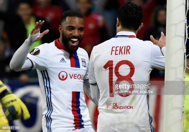 Lyon's Alexandre Lacazette and Nabil Fekir celebrates after scoring during the UEFA Europa League football match between Olympique Lyonnais and AZ...