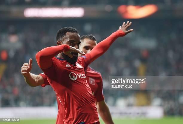 Lyon's Alexandre Lacazette celebrates after scoring a goal during the UEFA Europa League second leg quarter final football match between Besiktas and...