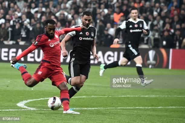Lyon's Alexandre Lacazette kicks the ball next to Besiktas' Dusko Tosic during the UEFA Europa League second leg quarter final football match between...