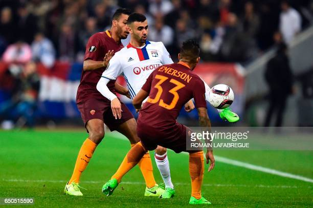 Lyon's Algerian forward Rachid Ghezzal vies with Roma's Brazilian defender Juan Jesus and Roma's Brazilian defender Emerson Palmieri during the...