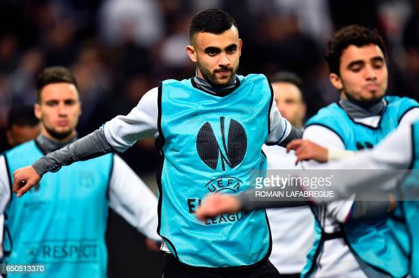 Lyon's Algerian forward Rachid Ghezzal warms up with teammates prior to the Europa League round of 16 first leg football match between Lyon and AS...