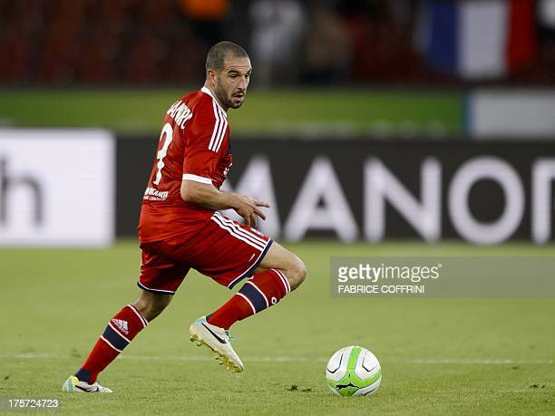Lyon's Argentine forward Lisandro Lopez controls the ball during an UEFA Champions League preliminary round second leg football match between...
