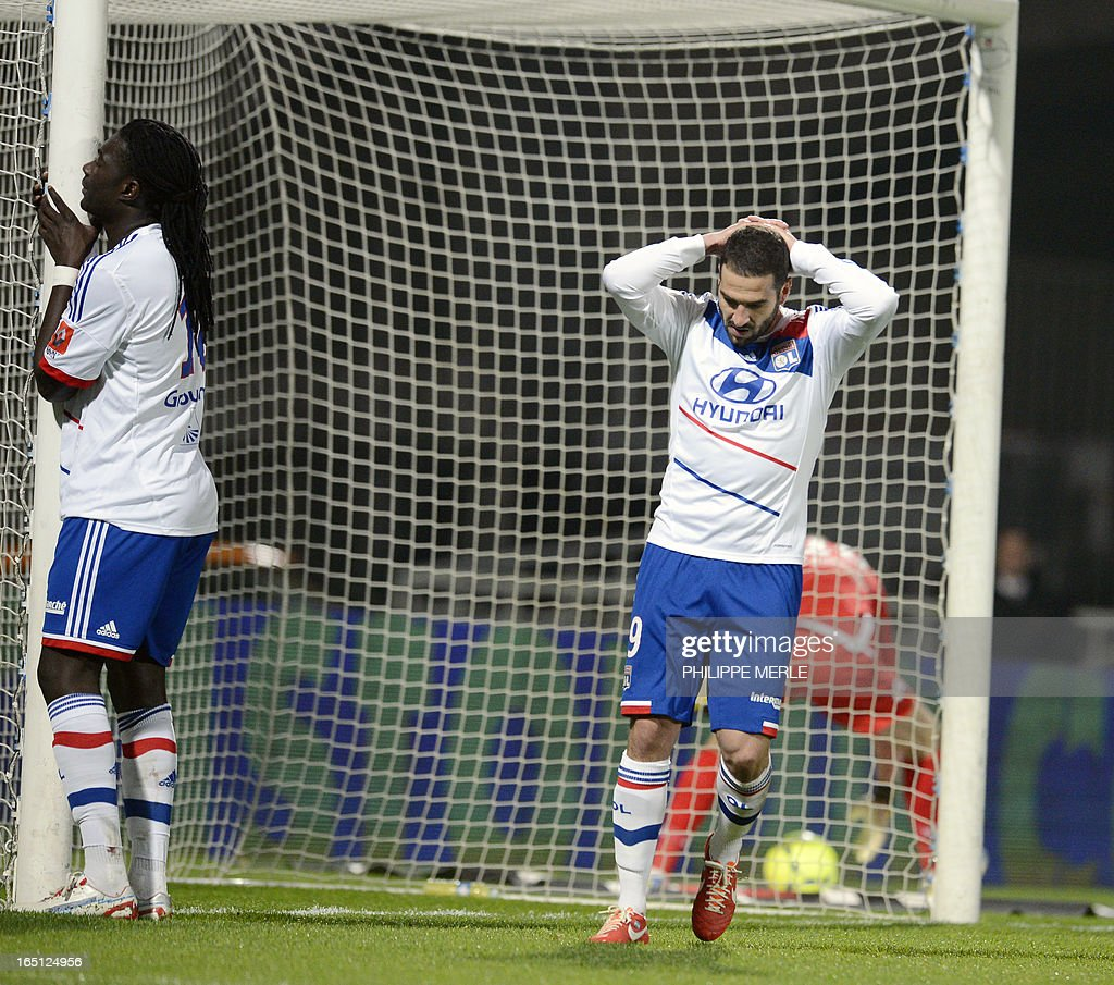 Lyon's Argentinian forward Lisandro Lopez (R) and Lyon's French forward Bafetimbi Gomis react during the French L1 football match Lyon vs Sochaux March 31 , 2013 at the Gerland stadium in Lyon.