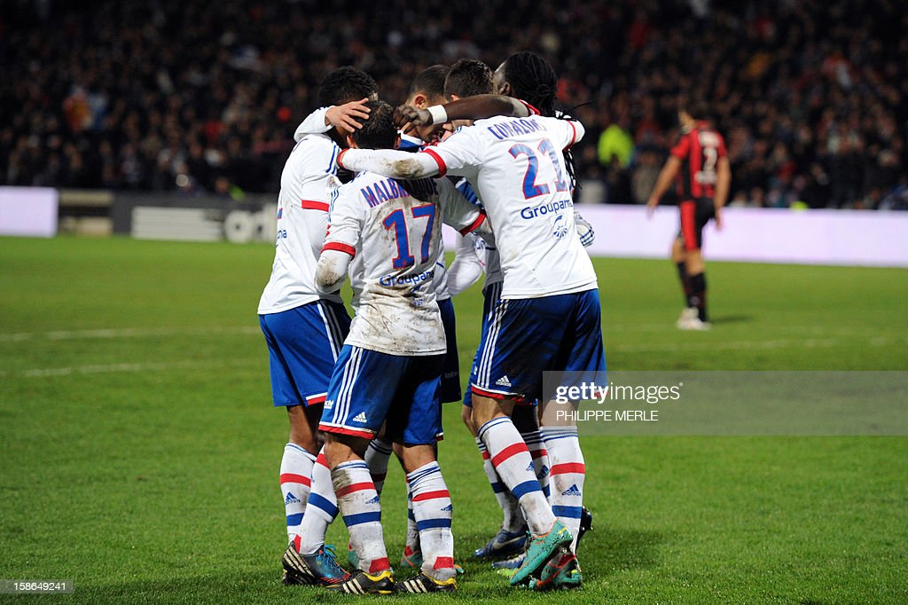 Lyon's Argentinian forward Lisandro Lopez is congratulated by teammates after scoring a goal during the French L1 football match Lyon vs Nice on December 22, 2012, at the Gerland stadium in Lyon.