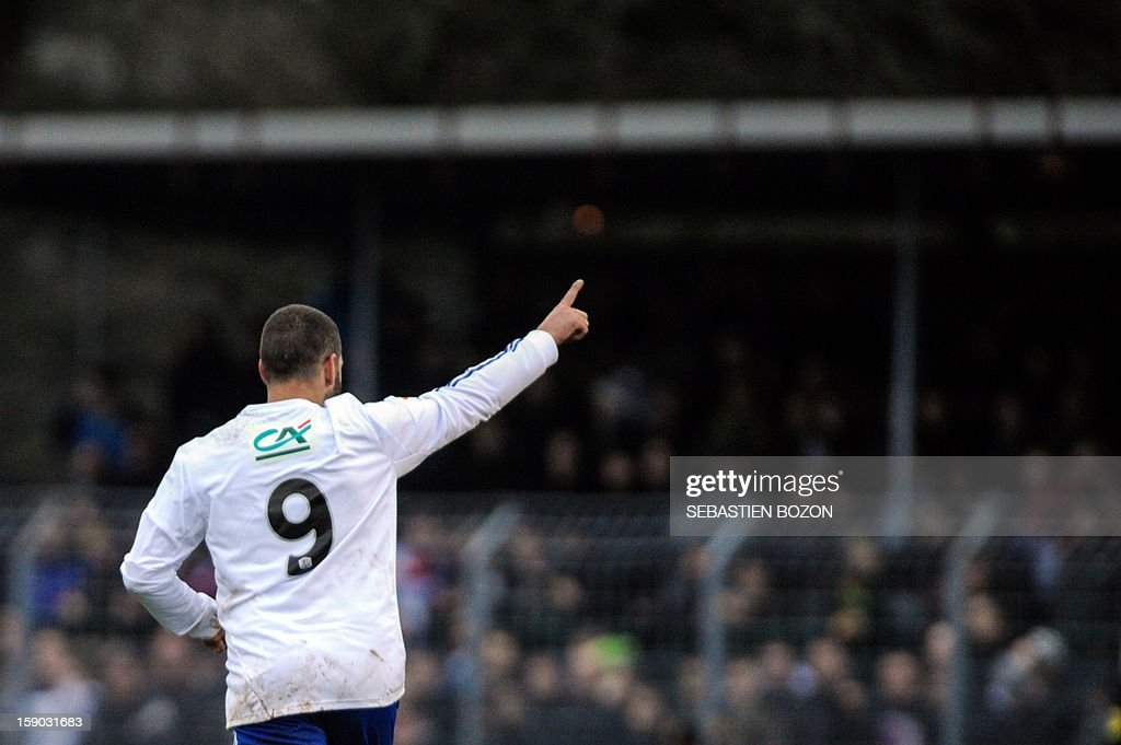 Lyon's Argentinian forward Lisandro Lopez (C) jubilates after scoring a goal during their French cup football match Epinal (SAS) versus Lyon (OL) at the Colombiere Stadium in Epinal, on January 6, 2013.