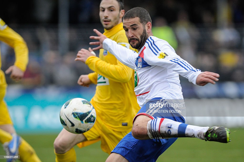 Lyon's Argentinian forward Lisandro Lopez kicks the ball during their French cup football match Epinal (SAS) versus Lyon (OL) at the Colombiere Stadium in Epinal, on January 6, 2013.