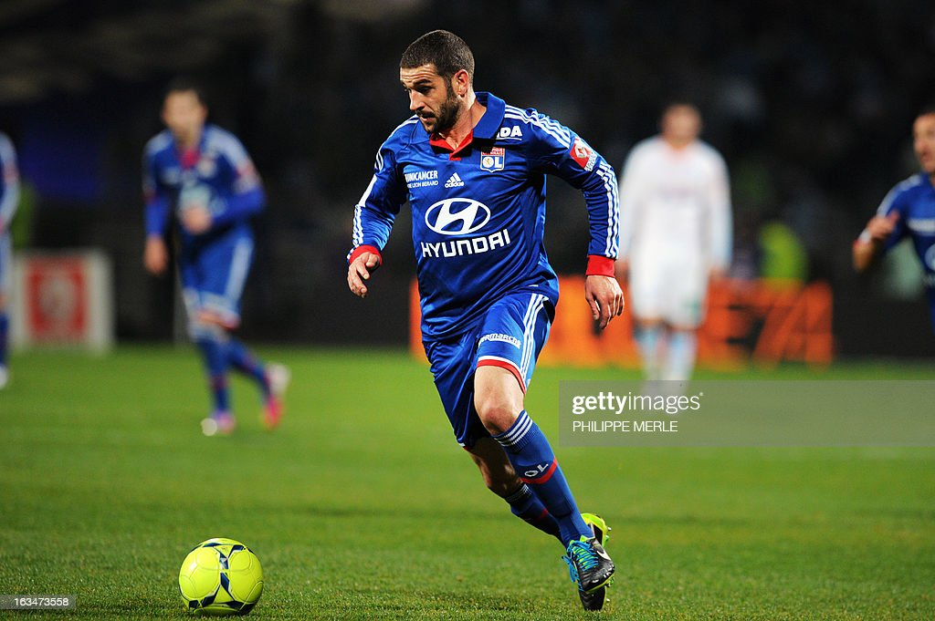 Lyon's Argentinian forward Lisandro Lopez runs with the ball during the French L1 football match Olympique Lyonnais (OL) vs Olympique de Marseille (OM) on March 10, 2013 at the Gerland stadium in Lyon, southeasthern France.