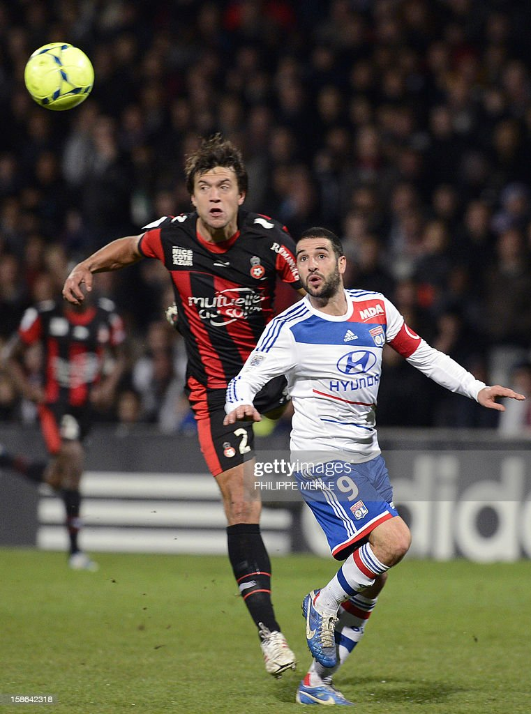 Lyon's Argentinian forward Lisandro Lopez (R) vies for the ball with Lyon's French defender Medhi Zeffane during the French L1 football match Lyon vs Nice on December 22, 2012, at the Gerland stadium in Lyon.