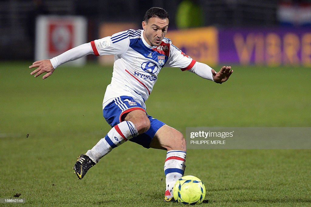 Lyon's Belgian midfielder Steed Malbranque shoots the ball during the French L1 football match Lyon vs Nice, on December 22, 2012 at the Gerland stadium in Lyon, central eastern France.