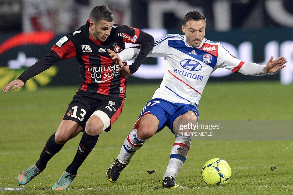 Lyon's Belgian midfielder Steed Malbranque (R) vies with Nice's French midfielder Valentin Eysseric during the French L1 football match Lyon vs Nice, on December 22, 2012 at the Gerland stadium in Lyon, central eastern France.