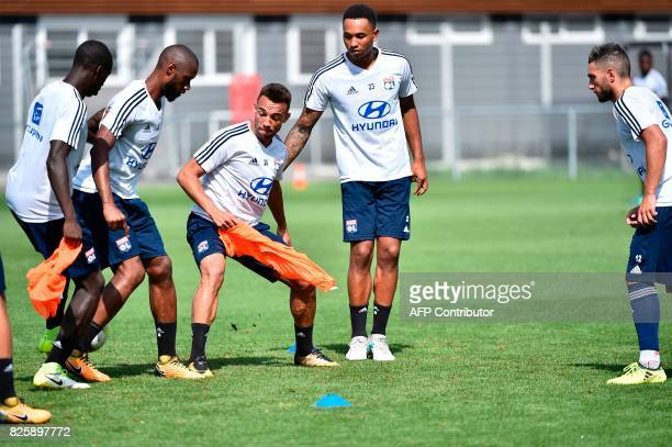 Lyon's Brazilian defender Fernando Marcal and Lyon's Dutch defender Kenny Tete take part in a training session on August 3 2017 at the Parc Olympique...