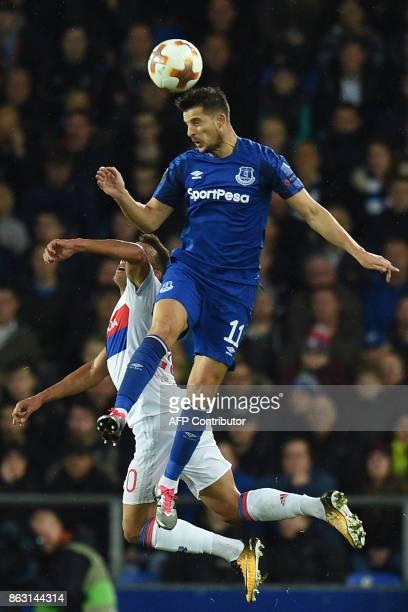 Lyon's Brazilian defender Fernando Marcal vies with Everton's Belgian striker Kevin Mirallas during the UEFA Europa League Group E match between...
