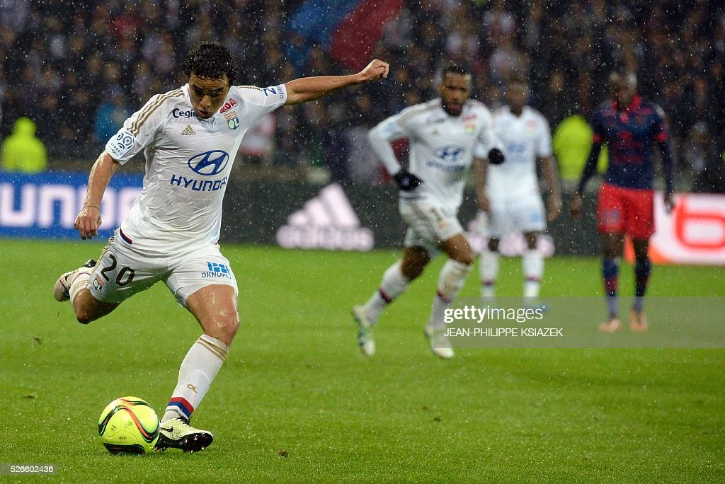 Lyon's Brazilian defender Rafael da Silva (L) kicks the ball during the French L1 football match Lyon (OL) vs Ajaccio (GFCA) at the Parc Olympique Lyonnais stadium in Decines-Charpieu, central eastern France, on April 30, 2016.