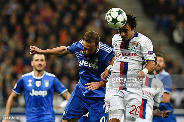 Lyon's Brazilian defender Rafael Da Silva vies with Juventus' Argentinan forward Gonzalo Higuain during the Champions League football match between...