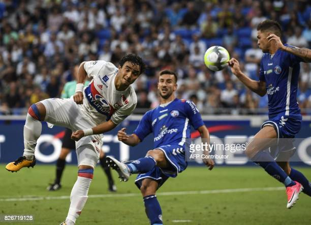 Lyon's Brazilian defender Rafael vies with Strasbourg's French defender Pablo Martinez during the Ligue1 football match Olympique Lyonnais against...