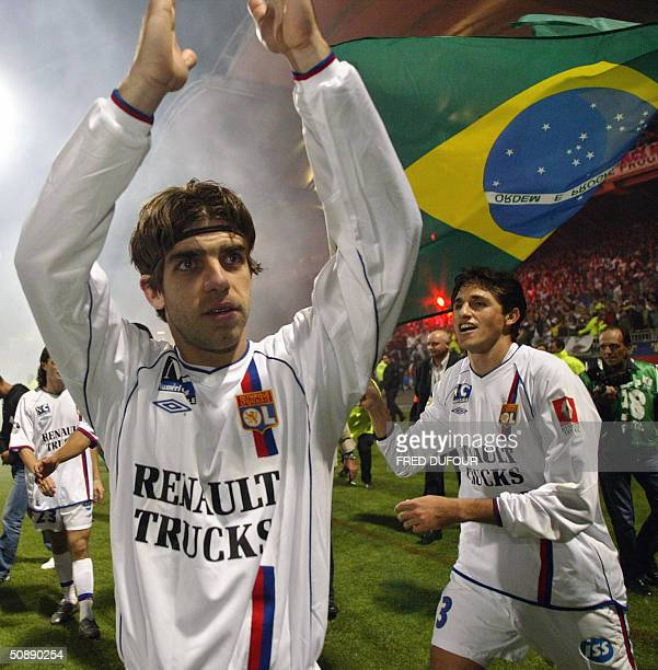 Lyon's Brazilian midfielder Juninho and defender Edmilson celebrates at the end of the French first league football match between Lyon and Lille 23...