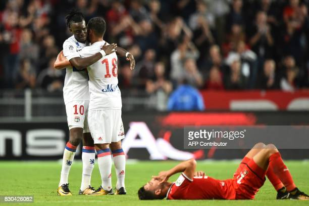 Lyon's Burkinabe forward Bertrand Traore celebrates with Lyon's French midfielder Nabil Fekir after the French L1 football match between Stade...