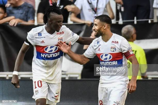 Lyon's Burkinabe forward Bertrand Traore celebrates with Lyon's French forward Nabil Fekir after scoring a goal during the L1 football match...