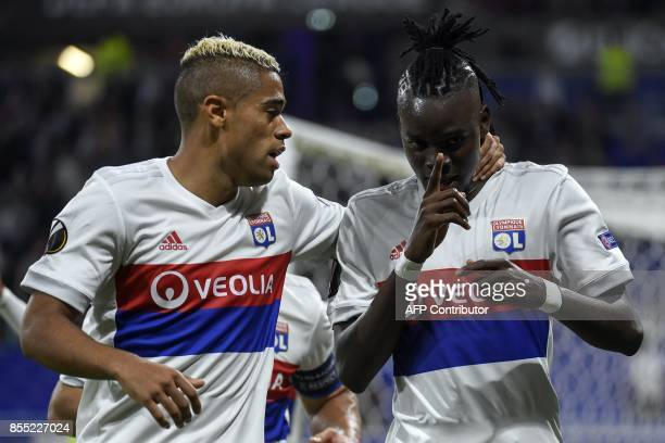 Lyon's Burkinabe forward Bertrand Traore celebrates with teammate Lyon's Spanish forward Mariano Diaz after scoring a goal during the Europa League...