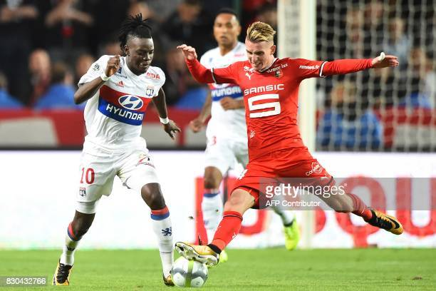 Lyon's Burkinabe forward Bertrand Traore vies for the ball with Rennes' French midfielder Benjamin Bouigeaud during the French L1 football match...