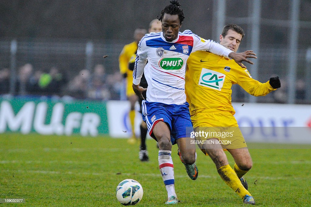 Lyon's Burkinabese defender Bakary Kone (C) vies for the ball with Epinal's French midfielder Romain Chouleur (R) during the French cup football match between Epinal (SAS) and Lyon (OL) at the Colombiere Stadium in Epinal, on January 6, 2013.